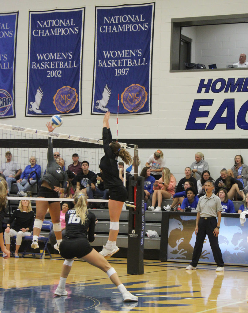 <strong>PHOTO BY Alexis Haggstrom</strong><br> #8 Madi Wagaman, sophomore, jumps to block a spike from a DMACC player as #16 Taylor Carey, sophomore, moves to support.