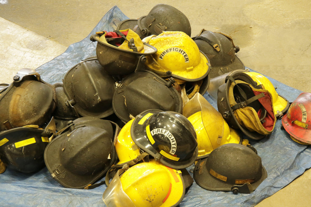 Fire helmets that have been through flashover training, the blackened ones represent ones that were closet to the heat.