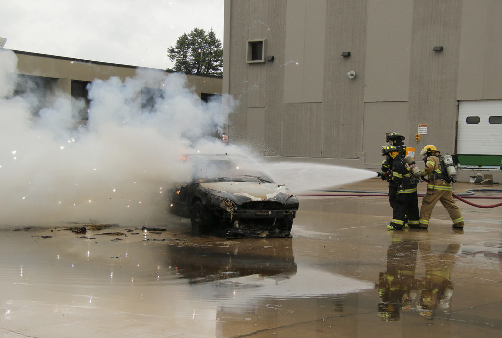 Fireworks fly from a vehicle as the airbag explodes as fire fighters apply water to it as part of their training at Kirkwood's Continuing Education facilities on Sept. 21-22.