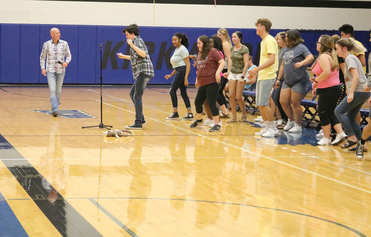 Photo of hypnotist Brian Imbus making student volunteers dance during a special event for Welcome Week in Johnson Hall on Aug.29.