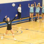 # 15 Rachel Nelson, freshman serves the ball during the game against Des Moines Area Community College on Sept 18.
