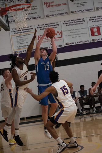 #13 Luke Appel goes hard in the paint against Ellsworth Community College players on Feb. 19.