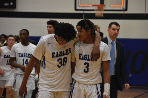 #30 DJ Purnell and #3 Chris Burnell celebrate Kirkwood's win against DMACC on Feb. 12.