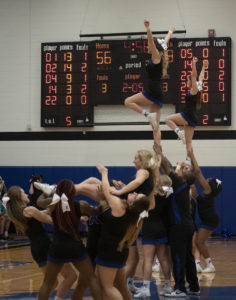 During a cheer routine one of the cheerleaders nearly falls at the Kirkwood vs. DMACC game on Feb. 12.