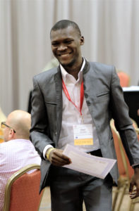 Communiqué Social Media Manager Desi Kouassi accepts a first place award during the Iowa College Media Association's annual convention in Des Moines.