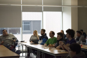 """Students attend a """"Pizza for President"""" event to learn about the Iowa Caucus in Cedar Hall on Jan. 30."""