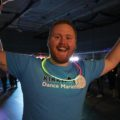 Kirkwood Dance Marathon Co-Chair Tyler Carlson, business management, celebrates during the final hour of KDM at the Rec Center on Feb. 21.