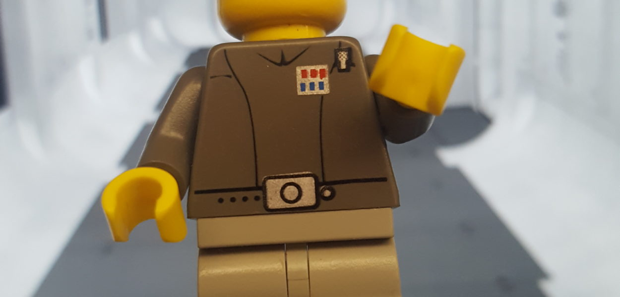 A LEGO minifigure from the 2001 Star Wars Final Duel II Lego set. The figure is dressed as an Imperial Officer.