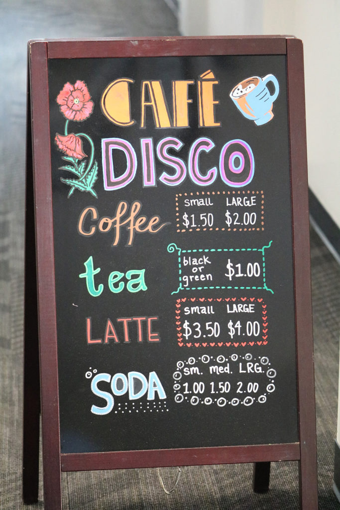 The menu outside Café Disco showcases drink prices.