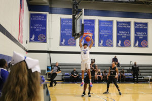 #40 Niko Gosnell, sophomore, slam dunks the ball during the quarterfinals of the NJCAA regional tournament against Little Priest Tribal College on March 3.