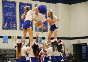 Cheerleaders perform a stunt during Kirkwood's Sophomore night Feb. 29.