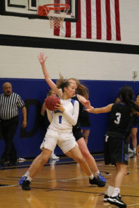 #1 Paige Bradford looks for an opening during Kirkwood's quarterfinals game against DMAC on March 5.