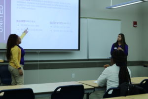 Photo of a UNI transfer event held in Cedar Hall on Feb. 11. Pictured are Juana Hollingswith and Sahira Garcia.