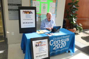 Photo of a booth on Feb. 11 advertising student job opportunities to work for the US Census Bureau.
