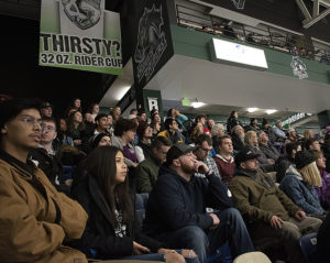 Photo of Kirkwood students enjoying student night at the the Roughriders hockey game on Jan. 31.