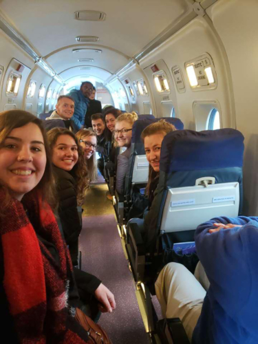 Photo of students posing during their flight tour of Mt. Everest.