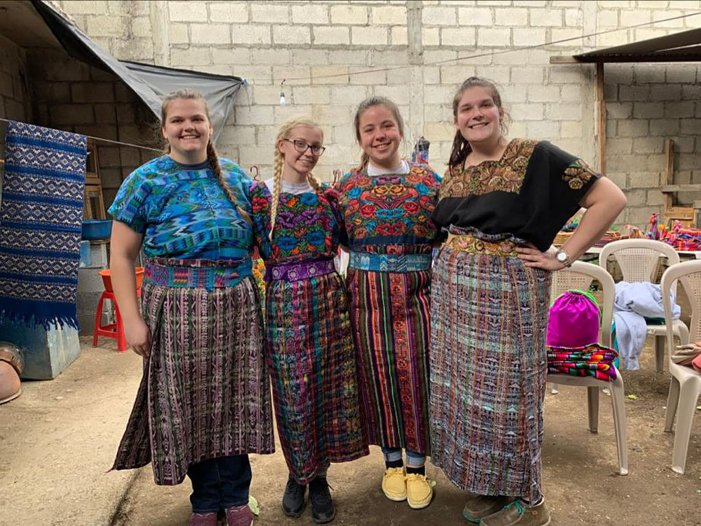 Photo of students trying on traditional clothing in Guatemala