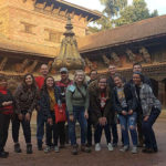 Photo of students posing while visiting a temple during the Nepal study abroad