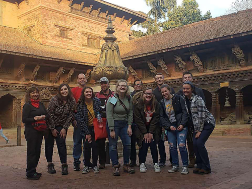 Photo of students posing while visiting a temple during the Nepal study abroad.