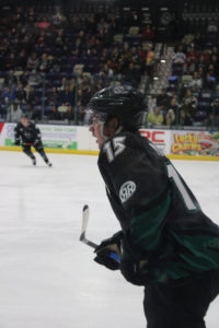 Photo of Roughrider defenseman, #15 Jack Millar, skating downrink toward his teammates during the game against the Youngstown Phantoms on Jan 31.