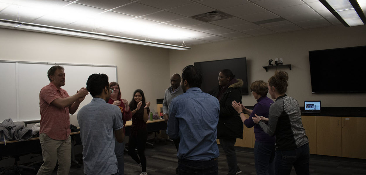 Photo of Professor Slav teaching students international folk dancing.