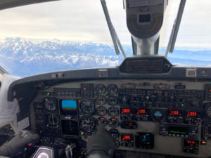 Photo of the control panel of an airplane as it over looks the Himalayas.